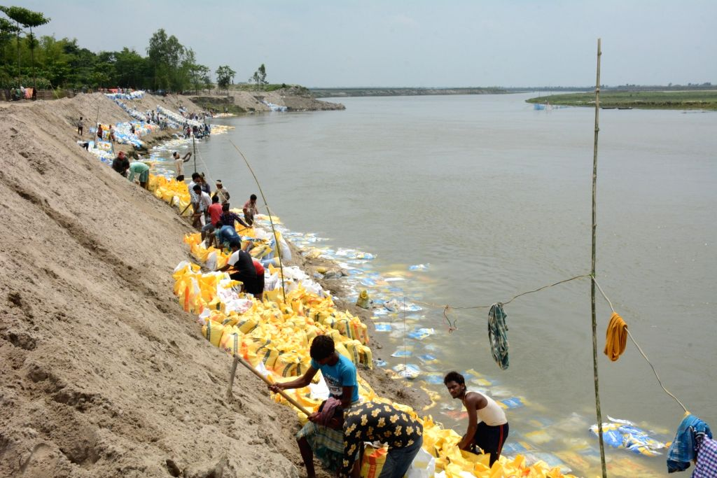 Labourers busy constructing a bridge over Mahananda river in Bihar's Katihar during the extended nationwide lockdown imposed to mitigate the spread of coronavirus; on Apr 25, 2020.