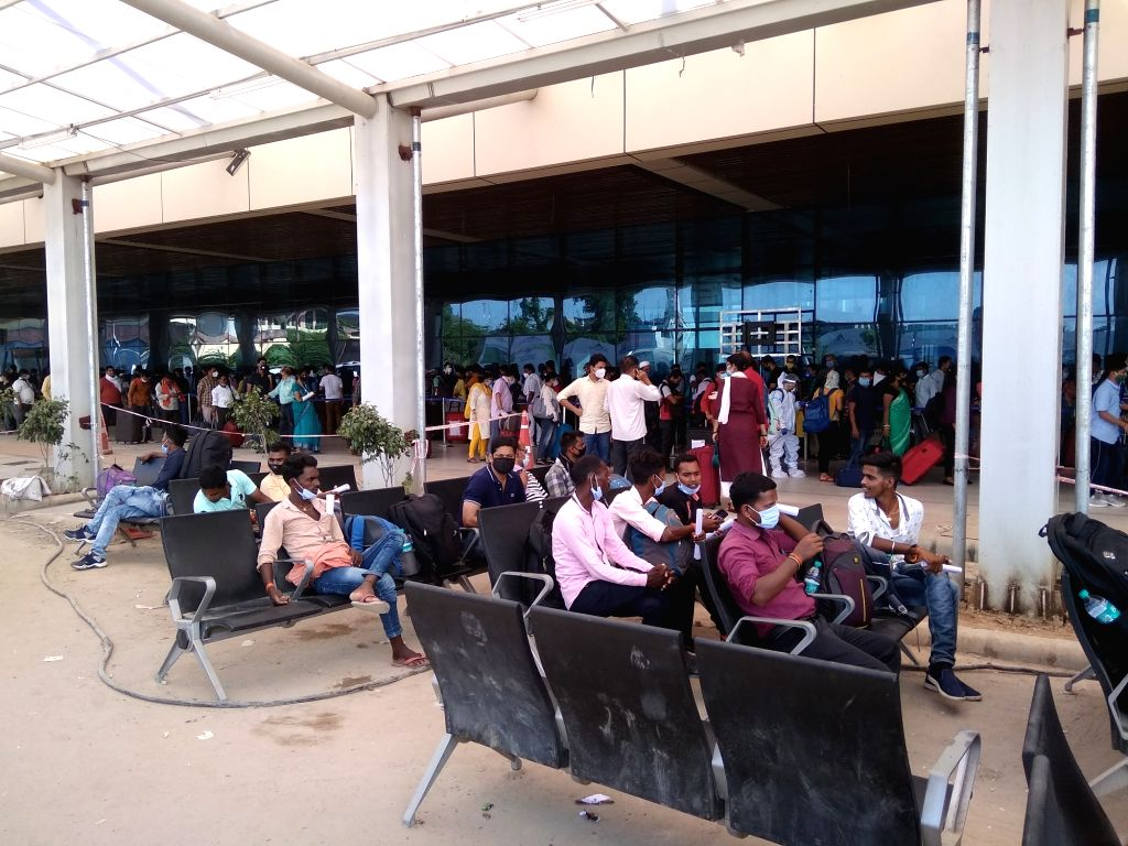 Labourers from Bihar waiting their turn to catch flights at Patna airport, in Patna on August 30, 2020.