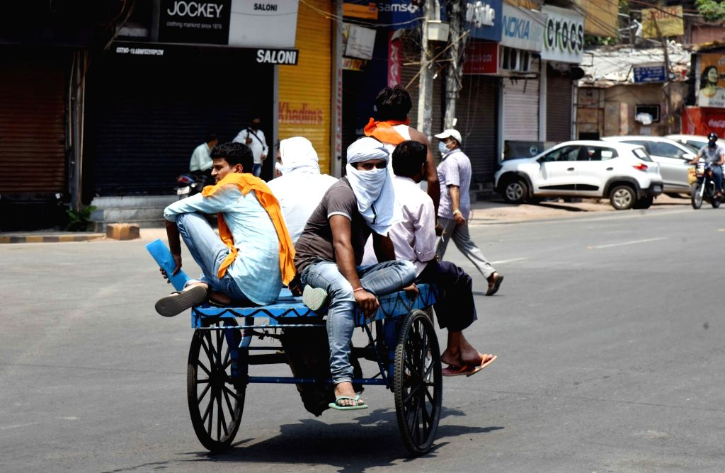 Labourers travel on a wooden cart in Patna during the extended nationwide lockdown imposed to mitigate the spread of coronavirus; on Apr 23, 2020.