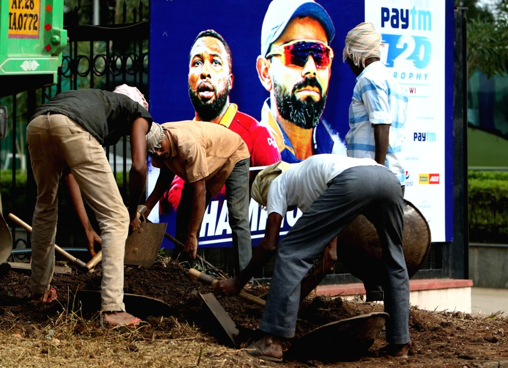 Labours at work ahead of the first Twenty20 match between India and West Indies at Rajiv Gandhi International Cricket Stadium in Hyderabad on Dec 4, 2019.