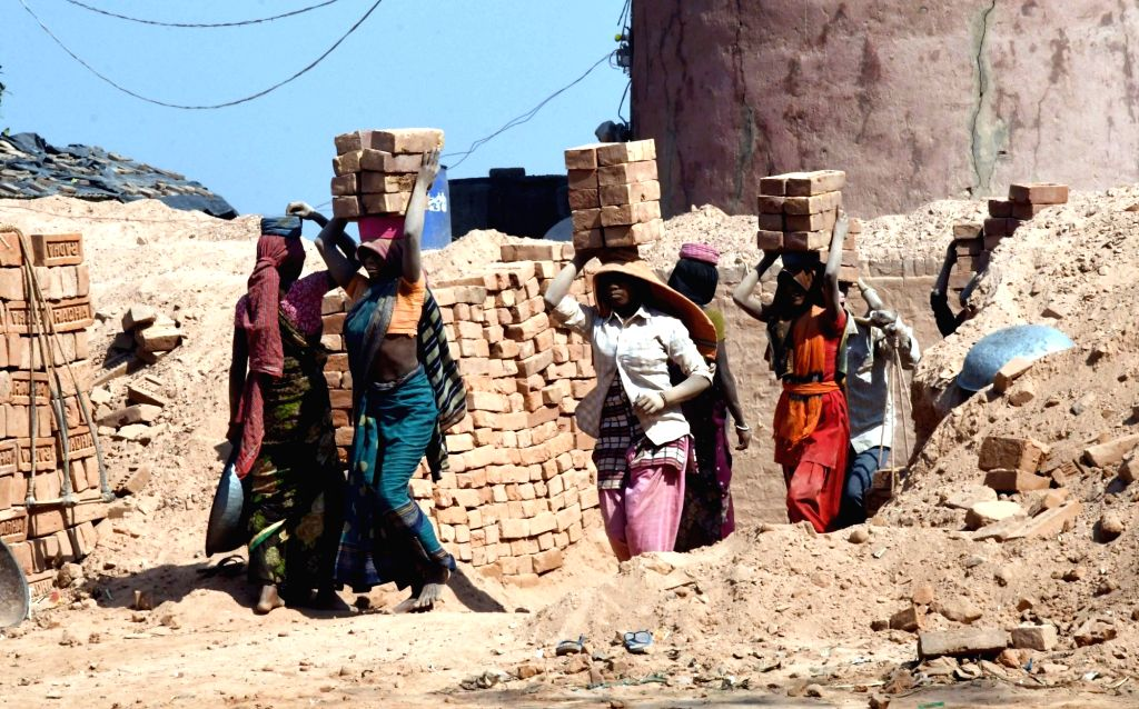 Labours busy working at a brick kiln, in Patna, on March 7, 2019.