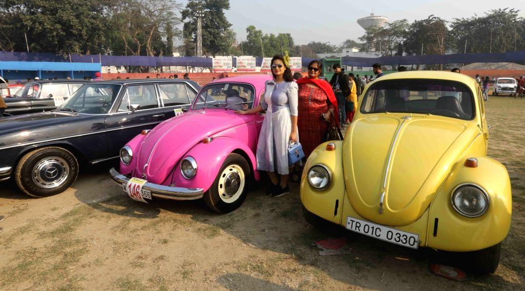 Ladies pose with vintage cars during vintage motor vehicle rally in Kolkata, on Feb 3, 2019.