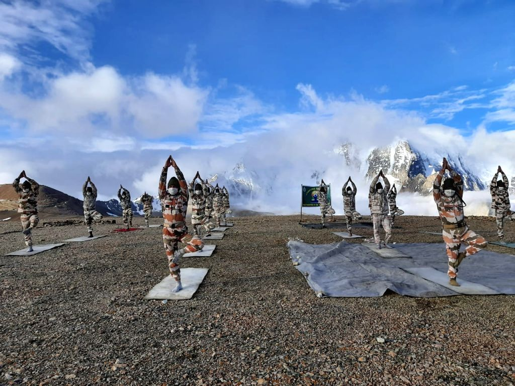 Ladkah: ITBP personnel practices yoga asanas - postures - at 18,800 feet on the occasion of 6th International Yoga Day in sub-zero temperature in Ladkah on June 21, 2020. (Photo: IANS/ITBP)