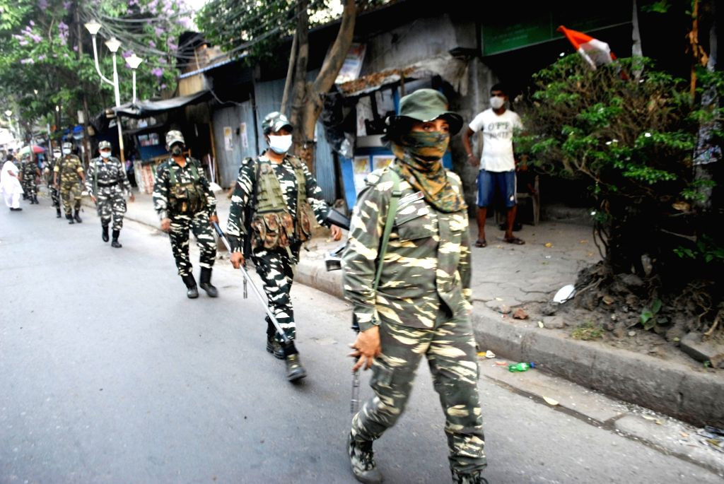 Lady Paramilitary forces personnel conduct a route march during the State Assembly election in Kolkata on April 14, 2021.