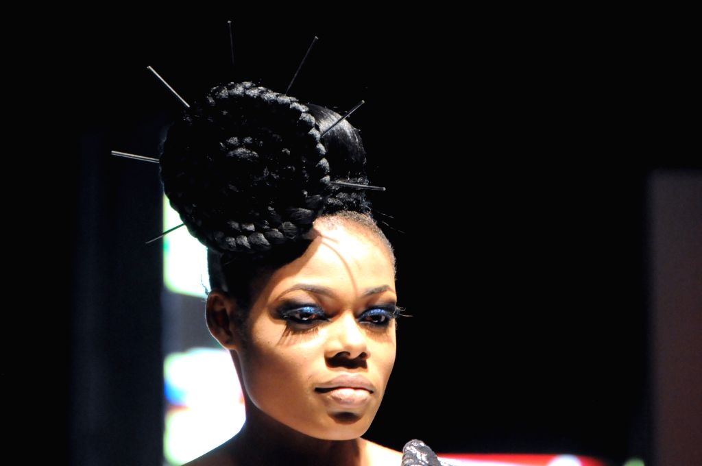 LAGOS, July 3, 2016 - Models presents a creation during the Africa Fashion Week Nigeria 2016 in Lagos, Nigeria, on July 2, 2016. The Africa Fashion Week Nigeria 2016 kicked off here on Saturday.