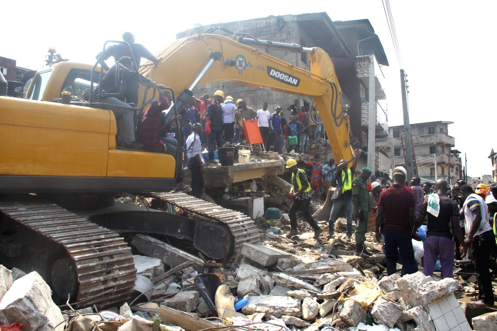 LAGOS, March 13, 2019 - Rescuers work at the site where a building collapsed in Lagos, Nigeria, on March 13, 2019. At least nine people have been killed and many others still trapped after a building ...