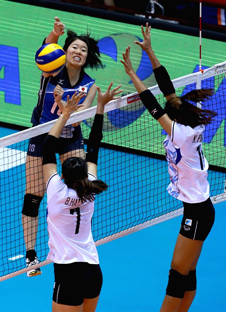 LAGUNA, Aug. 17, 2017 - Mami Uchiseto (top) of Japan smashes the ball against Thailand during the final match in the 2017 Asian Women's Volleyball Championship in Laguna Province, the Philippines, ...
