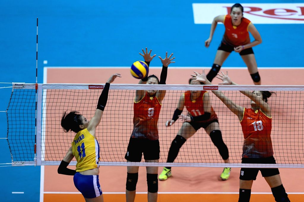 LAGUNA PROVINCE, Aug. 13, 2017 - Katerina Tatko (L) of Kazakhstan competes against Vietnam during their second round match in the 2017 Asian Women's Volleyball Championship in Laguna Province, the ...