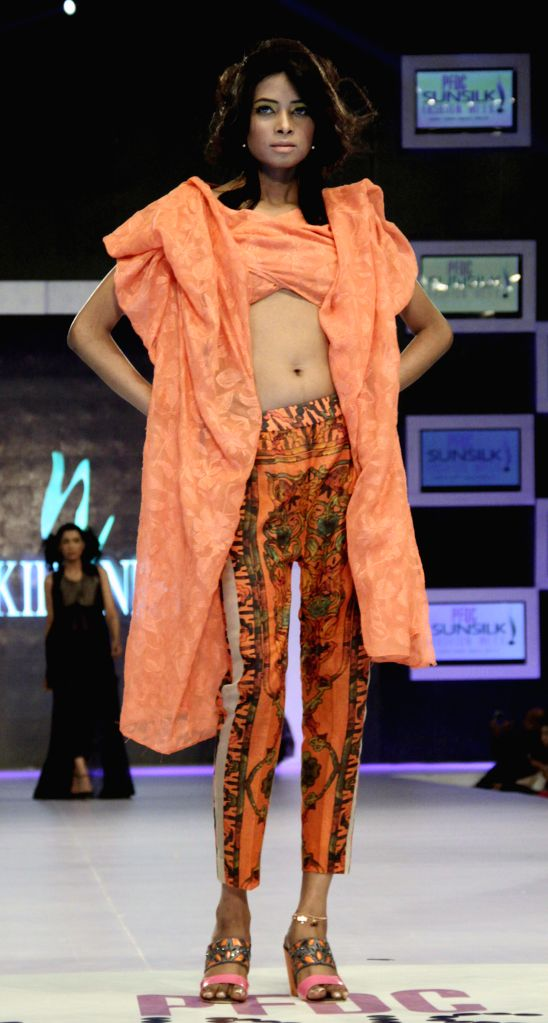 A model presents a creation by designer Nickie Nina on the first day of the Pakistan Fashion Design Council (PFDC) Sunsilk Fashion Week in eastern Pakistan's Lahore