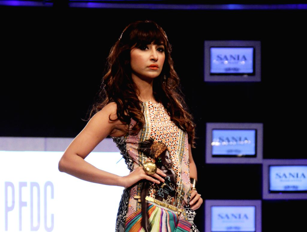 A model presents a creation by designer Xheikh Sharjeel on the first day of the PFDC Sunsilk Fashion Week in eastern Pakistan's Lahore on April 10, 2014.
