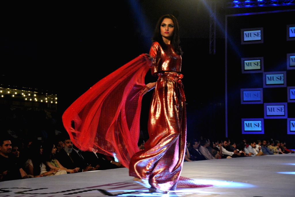 A model presents a creation by designer Muse on the second day of the PFDC Sunsilk Fashion Week in eastern Pakistan's Lahore on April 11, 2014. Photo: ...