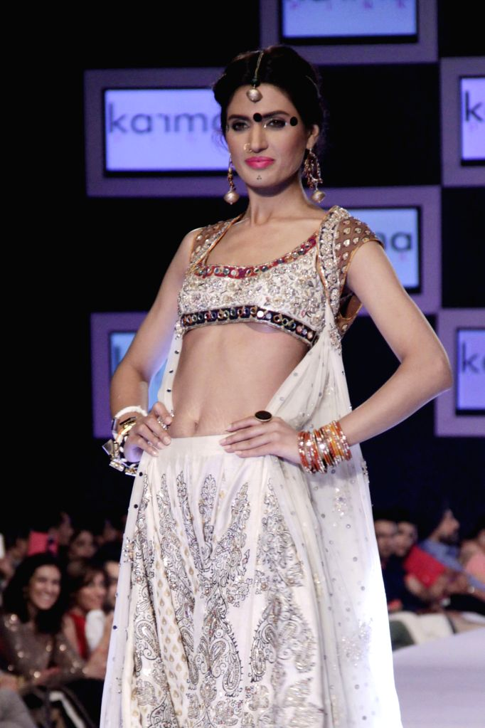 A model presents a creation by designer Deepak Perwani on the second day of the PFDC Sunsilk Fashion Week in eastern Pakistan's Lahore on April 11, 2014. Photo: ...