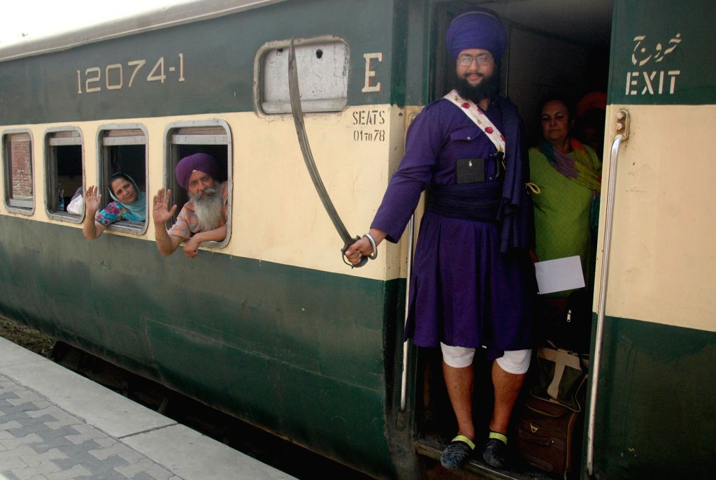 Indian Sikh pilgrims arrive at Wagah Railway Station in eastern Pakistan's Lahore, April 11, 2015. The first batch of Sikh pilgrims arrived in Pakistan from India ...