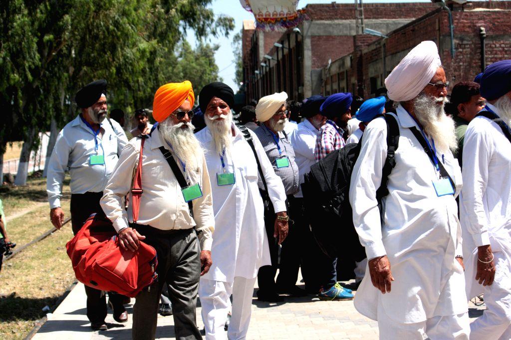 LAHORE, April 12, 2016 - Indian Sikh pilgrims arrive at the Wagah railway station in Lahore, eastern Pakistan, April 12, 2016. About 460 Indian Sikh pilgrims arrived in Pakistan for Baisakhi's ... - Nanak Dev