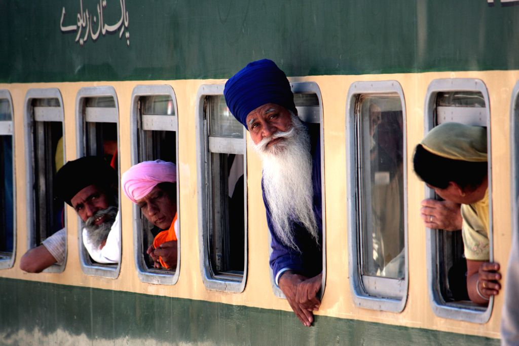 LAHORE, April 12, 2016 - Indian Sikh pilgrims look out from a train as they arrive at the Wagah railway station in Lahore, eastern Pakistan, April 12, 2016. About 460 Indian Sikh pilgrims arrived in ... - Nanak Dev