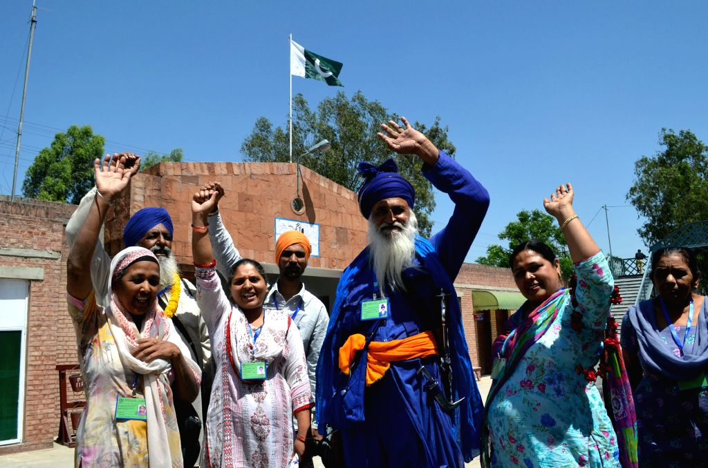 LAHORE, April 12, 2016 - Indian Sikh pilgrims wave as they arrive at the Wagah railway station in Lahore, eastern Pakistan, April 12, 2016. About 460 Indian Sikh pilgrims arrived in Pakistan for ... - Nanak Dev