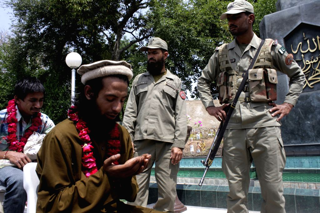 A released Pakistani prisoner prays at Wagah border in eastern Pakistan's Lahore, April 16, 2014. The Indian government in a goodwill gesture released 18 Pakistani .
