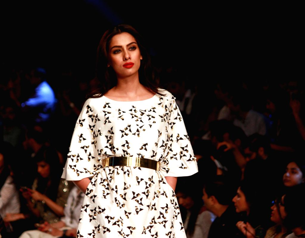A model presents a creation by designer Muse during the Pakistan Fashion Design Council (PFDC) Sunsilk Fashion Week in eastern Pakistan's Lahore on April 19, 2015. ...