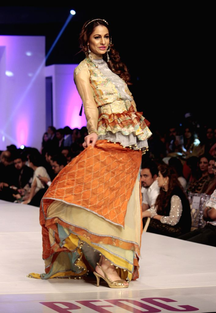 A model presents a creation by designer Warda during Pakistan Fashion Design Council (PFDC) Sunsilk Fashion Week in eastern Pakistan's Lahore on April 20, 2015. ...