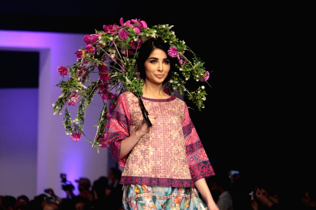 A model presents a creation by designer Ittehad during the Pakistan Fashion Design Council (PFDC) Sunsilk Fashion Week in eastern Pakistan's Lahore on April 20, ...