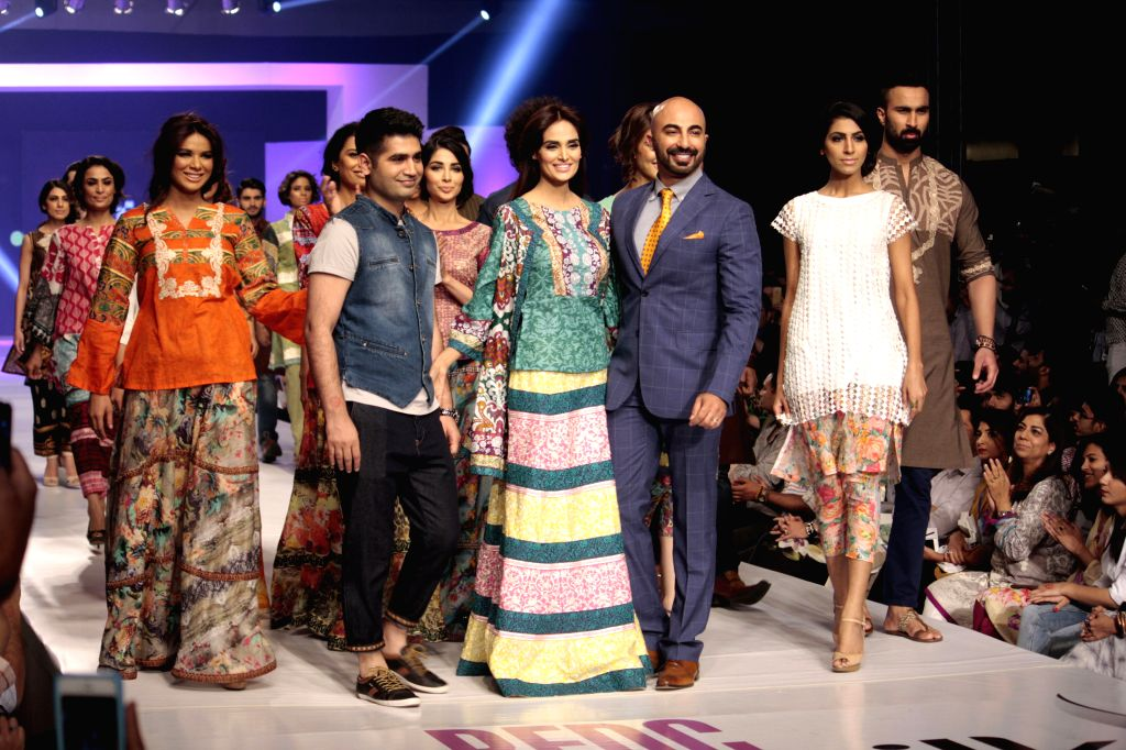 Model present creations by designer Ittehad during the Pakistan Fashion Design Council (PFDC) Sunsilk Fashion Week in eastern Pakistan's Lahore on April 20, 2015. ...