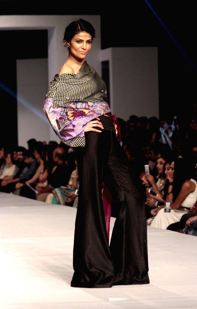 A model presents a creation by designer Sania Maskatiya during Pakistan Fashion Design Council (PFDC) Sunsilk Fashion Week in eastern Pakistan's Lahore on April 21, ...