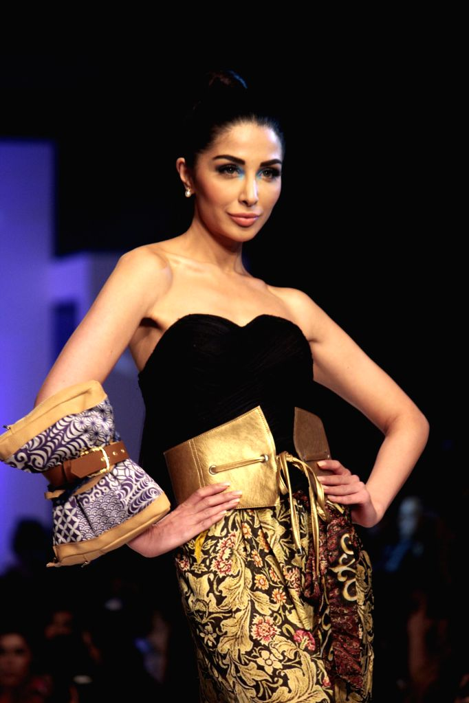 A model presents a creation by designer HSY during the last day of Pakistan Fashion Design Council (PFDC) Sunsilk Fashion Week in eastern Pakistan's Lahore on April ...