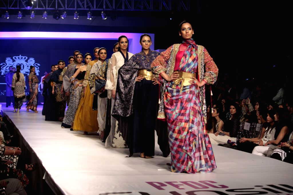 Model present creations by designer HSY during the last day of Pakistan Fashion Design Council (PFDC) Sunsilk Fashion Week in eastern Pakistan's Lahore on April 21, ...