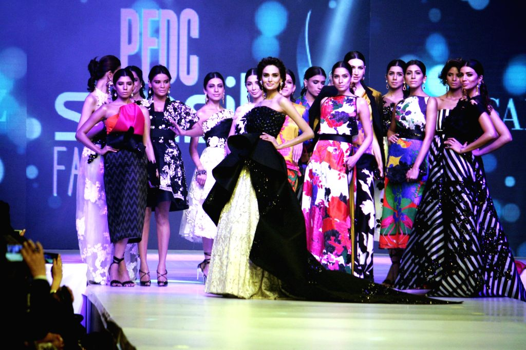 Models present creations by designer Sana Safinaz during the last day of Pakistan Fashion Design Council (PFDC) Sunsilk Fashion Week in eastern Pakistan's Lahore, ...