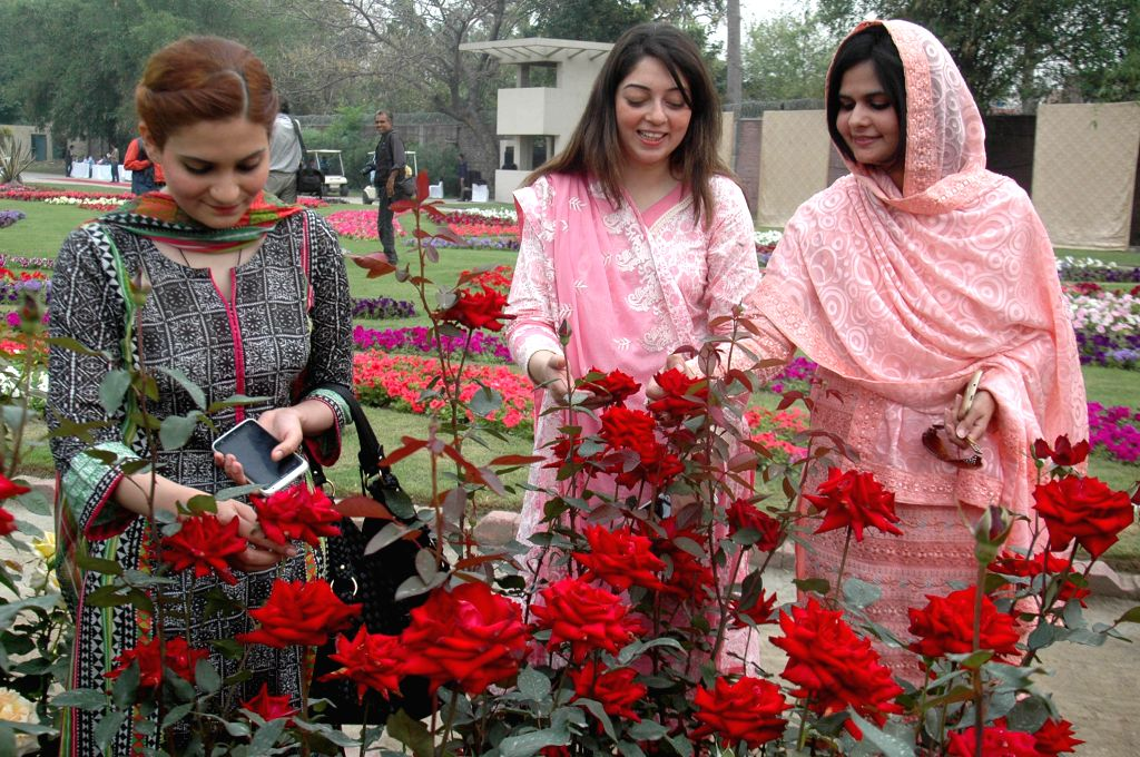 Vistors view flowers at a spring flower show in eastern Pakistan's Lahore, on April 7, 2015. Flowers are in full blossom as temperature rises in ...