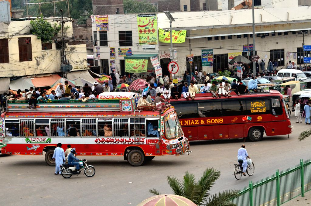 LAHORE, Aug. 11, 2019 - Passengers are seen on an overcrowded bus ahead of the Eid al-Adha festival in Lahore, Pakistan, on Aug. 11, 2019.