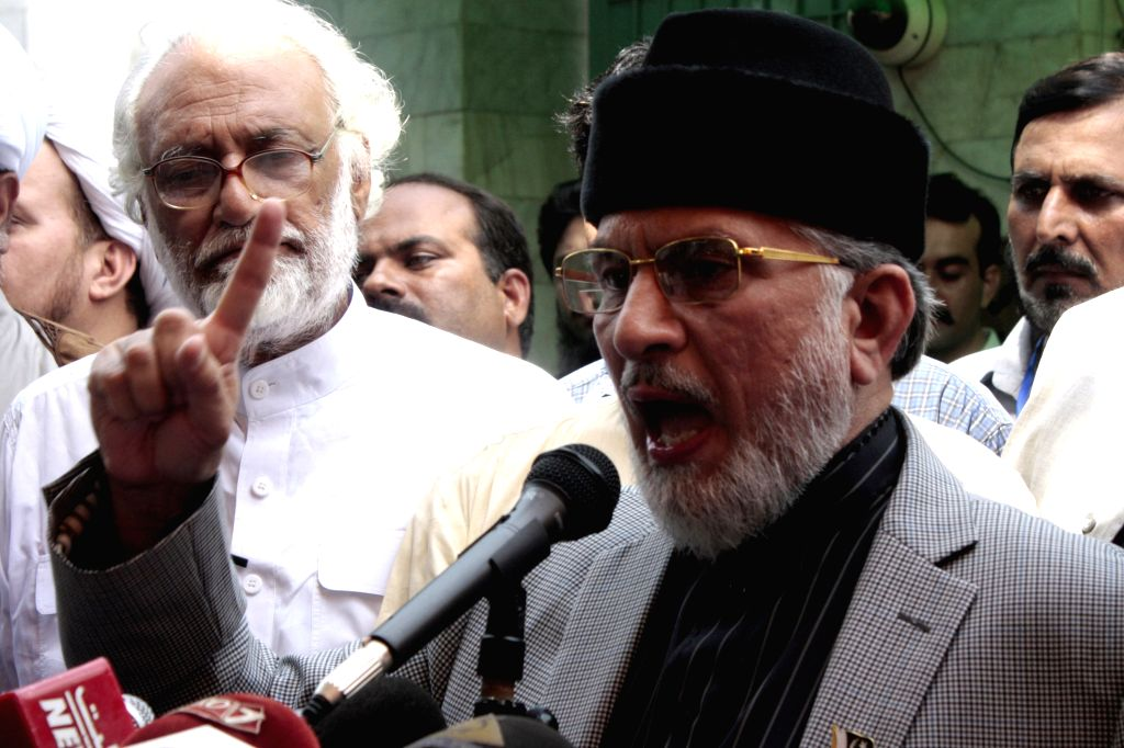 Anti-government cleric Tahir-ul-Qadri speaks to the media ahead of the long march in eastern Pakistan's Lahore on Aug. 14, 2014. Thousands of Pakistani people, ...