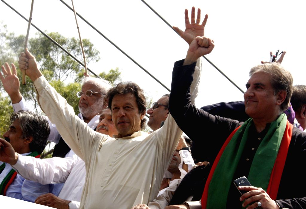 Pakistan senior opposition leader Imran Khan (L, front) gestures as he heads a protest march from Lahore to Islamabad against the government, in east Pakistan's ... - Imran Khan