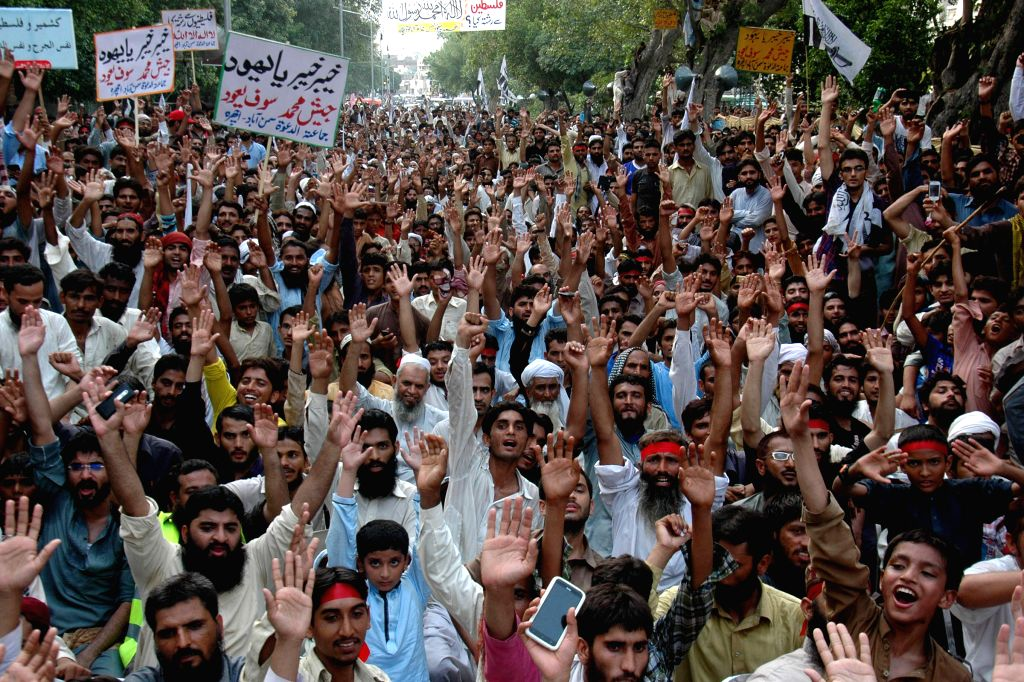 Pakistani people shout slogans during a rally against the Israeli air strike on the Gaza Strip, in eastern Pakistan's Lahore on Aug. 3, 2014.  ...