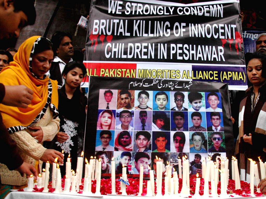 Pakistani Christians light candles for the victims of the Peshawar school massacre after mass prayer at a church in east Pakistan's Lahore on Dec. 21, 2014. At least