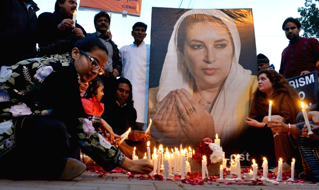 LAHORE, Dec. 27, 2015 (Xinhua) -- Activists of the Pakistan Peoples Party light candles on the death anniversary of former prime minister Benazir Bhutto in eastern Pakistan's Lahore on Dec. 27, 2015. Bhutto was assassinated on Dec. 27, 2007 following - Benazir Bhutto
