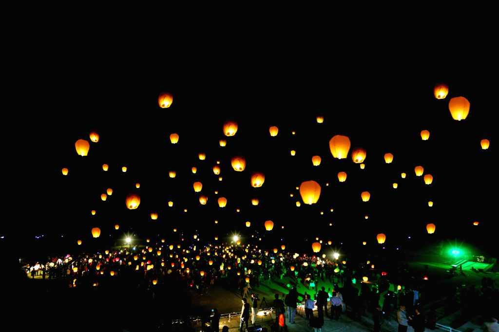 Photo provided by University of Engineering and Technology (UET) on Feb. 19, 2015, shows students launching sky lanterns on the closing ceremony of Annual Book Fair ...