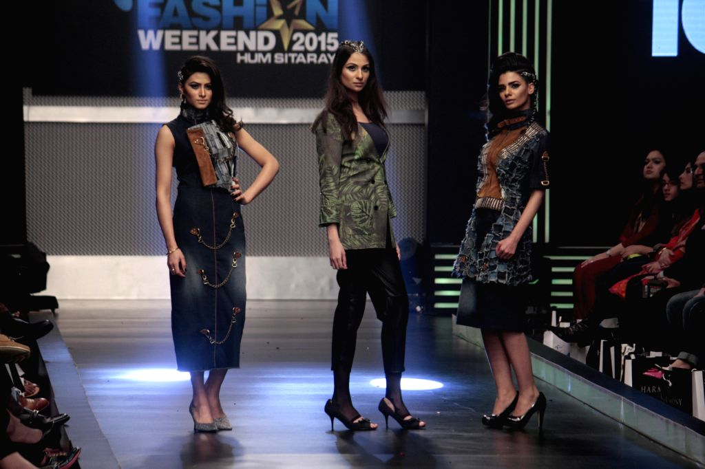 Models present creations of Toni and Guy on the last day of Lahore Fashion Week in east Pakistan's Lahore, Feb. 21, 2015.