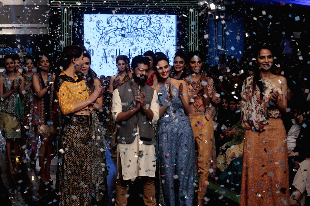Models present creations by designer Pareesa on the last day of Lahore Fashion Week in east Pakistan's Lahore, Feb. 21, 2015.