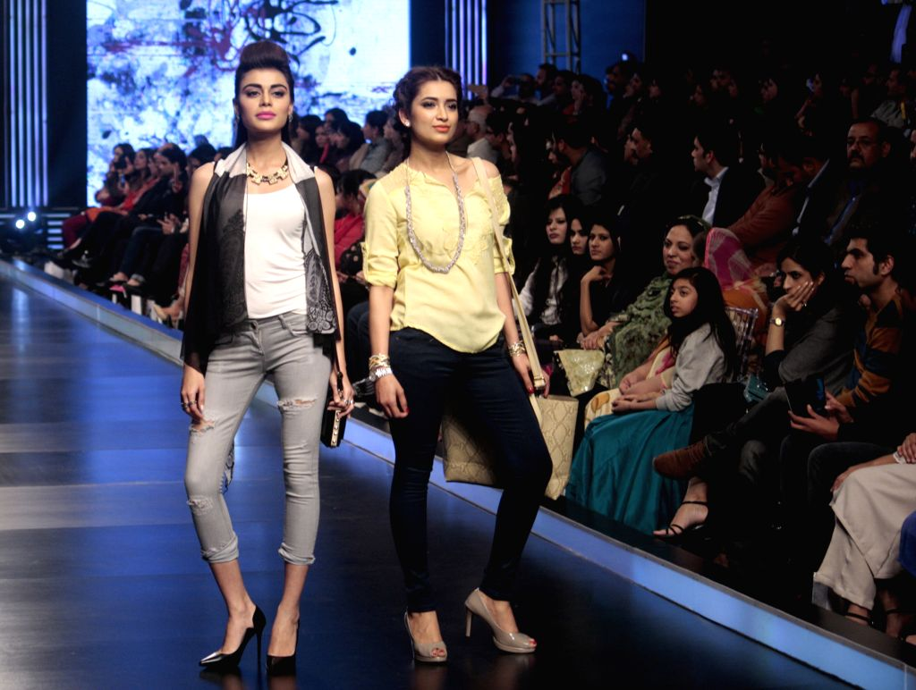 Models present creations by designer Aliza during Lahore Fashion Week in east Pakistan's Lahore, Feb. 21, 2015.