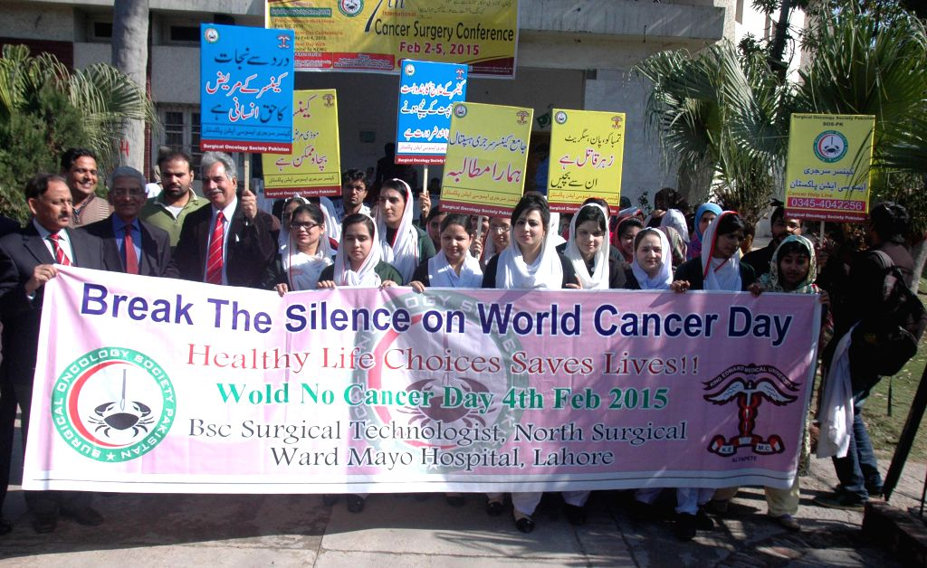 Pakistani nurses and doctors attend a rally to mark World Cancer Day in eastern Pakistan's Lahore, Feb. 4, 2015. Pakistan observed World Cancer Day on Wednesday with .