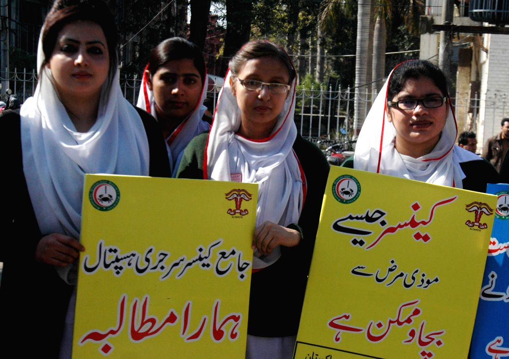 Pakistani nurses attend a rally to mark World Cancer Day in eastern Pakistan's Lahore, Feb. 4, 2015. Pakistan observed World Cancer Day on Wednesday with the rising ..