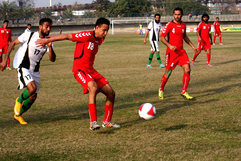 Afghanistan's Abdur Zakir (2nd L, front) vies with Pakistan's Mohammad Sadiq (1st L, front) during a friendly soccer match between Pakistan and Afghanistan in eastern