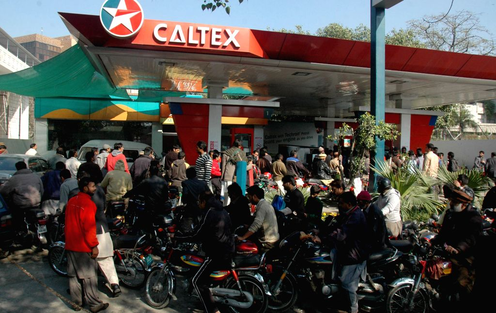 Motorbike riders queue at a fuel station due to petrol shortage in east Pakistan's Lahore, Jan. 16, 2015. Shortage of petrol continued on the fourth day in various ..