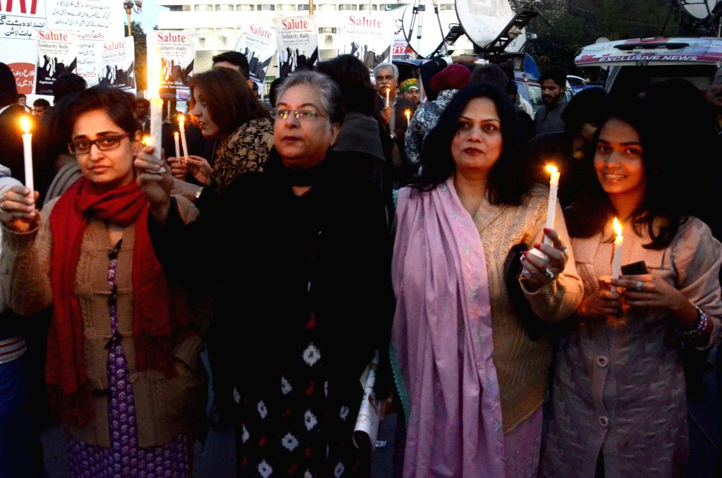 Pakistani civil society activists hold candles during a protest against terrorism in Lahore, eastern Pakistan on Jan. 16, 2015.