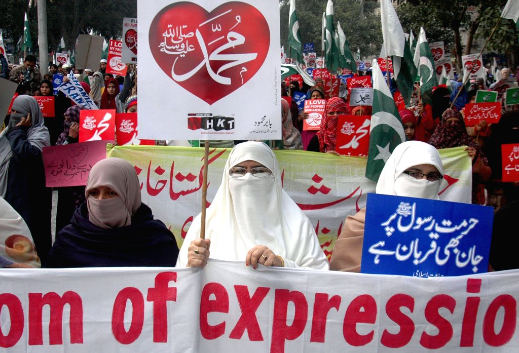 Supporters of Pakistani religious groups hold placards during a protest against caricatures published in French magazine Charlie Hebdo in eastern Pakistan??s Lahore,