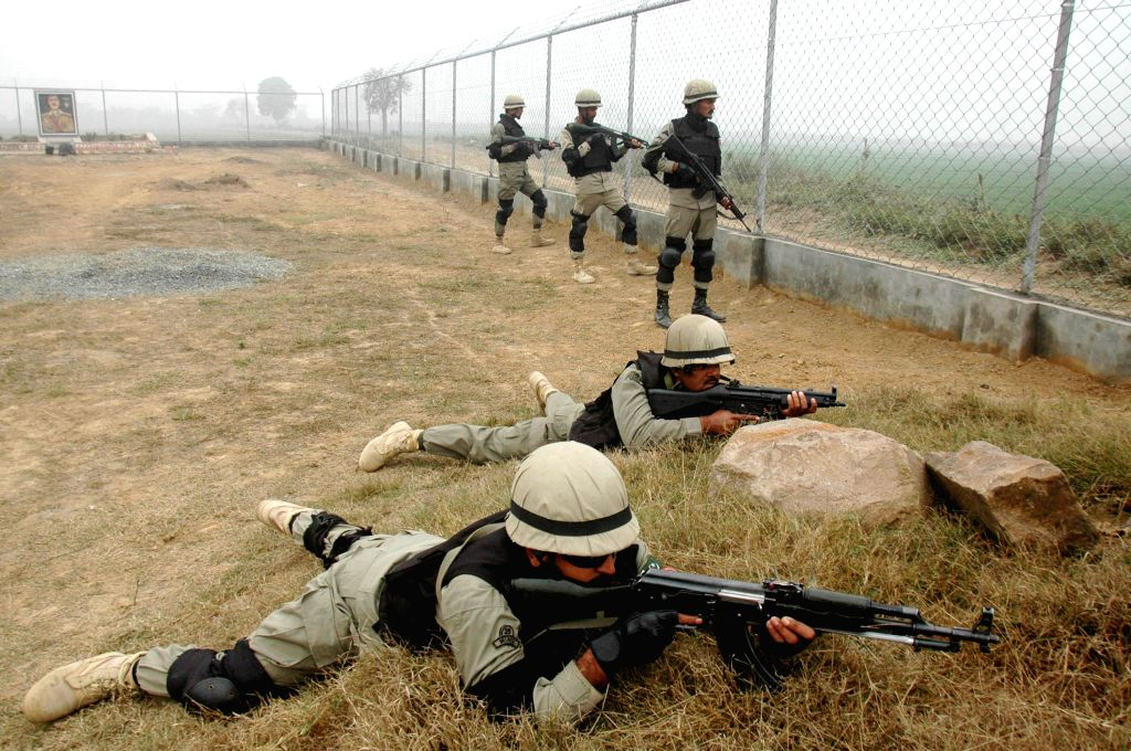 Pakistani rangers guard along the Pakistan-India border area of Wagah in eastern Pakistan's Lahore on Jan. 3, 2015. Pakistan army said that Indian forces shelled its .