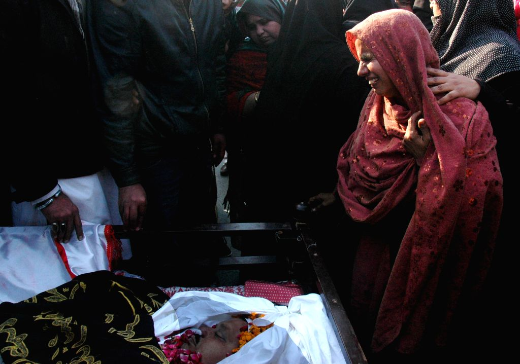 A Pakistani Shiite Muslim woman mourns during a funeral ceremony of Shikarpur blast victim in eastern Pakistan's Lahore on Jan. 31, 2015. At least 54 people were ...
