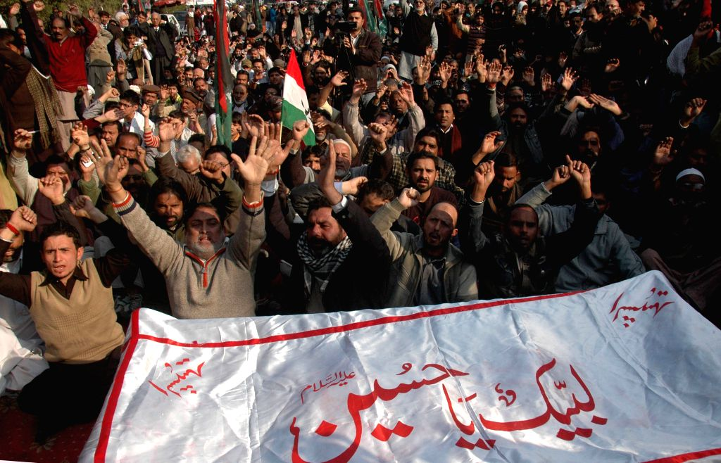 Pakistani Shiite Muslims shout slogans as they attend funeral ceremony of Shikarpur blast victim in eastern Pakistan's Lahore on Jan. 31, 2015. At least 54 people ...