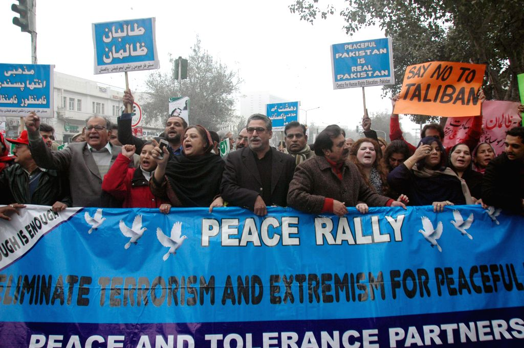 Pakistani civil society activists shout slogans against the Taliban during a peace rally in eastern Pakistan's Lahore on Jan. 5, 2015. Pakistan announced a national ..